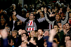 Sunderland fans celebrate in the stands as Sunderland's Joel Asoro scores the first goal of the game during the Sky Bet Championship match at Craven Cottage, London.