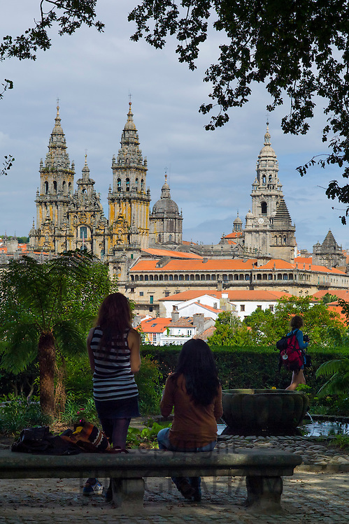 Young tourists in Alameda Park view Roman Catholic cathedral, Catedral de Santiago de Compostela, cityscape, Galicia, Spain