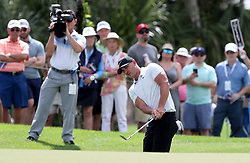 February 28, 2019 - Palm Beach Gardens, Florida, U.S. - Brooks Koepka hits out of the bunker on the 6th hole during the first round of the Honda Classic Thursday at PGA National Resort and Spa in Palm Beach Gardens, February 28, 2019. (Credit Image: © Allen Eyestone/The Palm Beach Post via ZUMA Wire)