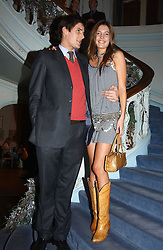 AMANDA SHEPPARD and RICHARD O'HAGAN at jewellers Tiffany's Christmas party held at The Savile Club, 69 Brook Street, London on 14th December 2004.<br /><br />NON EXCLUSIVE - WORLD RIGHTS