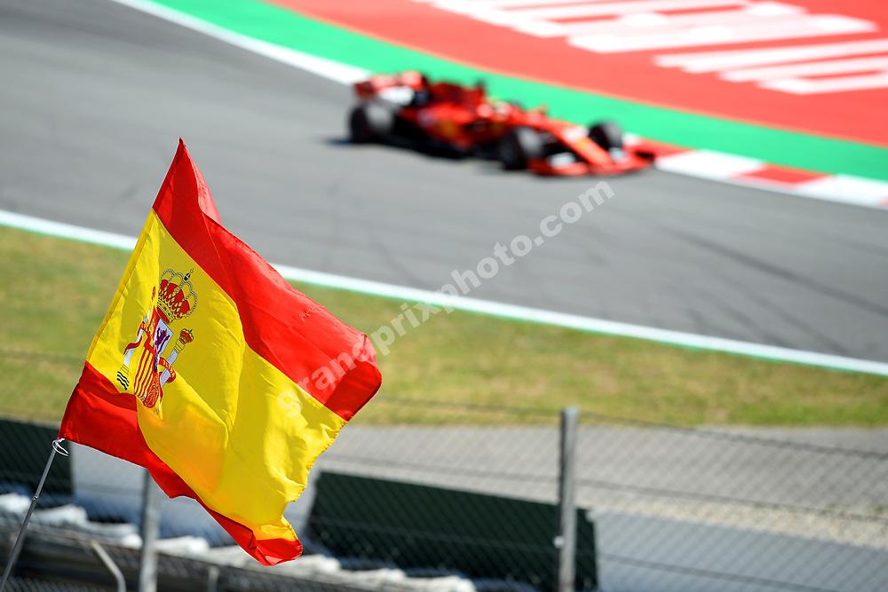 Spanish flag in front of Sebastian Vettel (Ferrari) during practice before the 2019 Spanish Grand Prix at the Circuit de Barcelona-Catalunya. Photo: Grand Prix Photo
