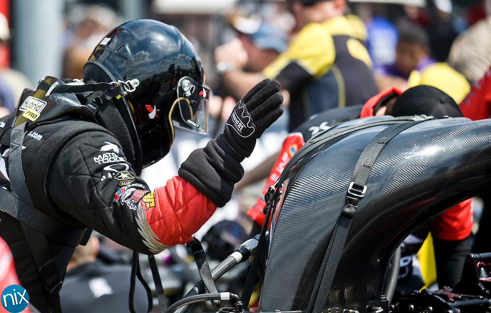 Top Fuel driver Spencer Massey gets ready for the second round of eliminations of the Dollar General NHRA Four-Wide Nationals at zMAX Dragway in Concord Sunday afternoon.
