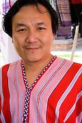 Man of the Karen Community from Burma (Myanmar) wears ethnic clothing. Dragon Festival Lake Phalen Park St Paul Minnesota USA