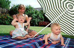 Mother and twin babies UK