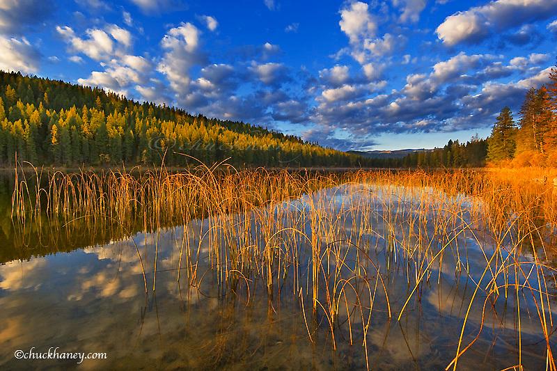 Sunrise lights clouds over Spencer Lake near Whitefish Montana
