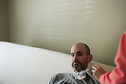 VESTAVIA HILLS, AL – DECEMBER 4, 2014: <br /> Former NFL fullback Kevin Turner rests on the bed where he receives full time care. Since his diagnosis with ALS in 2010, Turner's condition has deteriorated rapidly – leaving him dependent on a feeding tube for meals and a ventilator to help him breathe. Turner is one of the lead plaintiffs in the ongoing concussion litigation against the NFL. (Photo by Bob Miller/For The Washington Post)