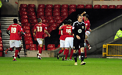 Bristol City's David Clarkson walks back to the centre circle as Nottingham Forest's Chris Cohen  and team mates celebrate in the back ground - Photo mandatory by-line: Matt Bunn/JMP - 25/01/2011 - SPORT - FOOTBALL - npower championship-Nottingham Forest v Bristol city-City Ground-Nottingham
