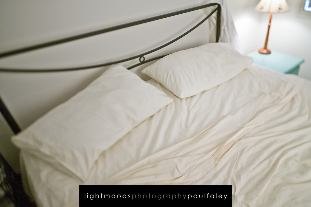 Unmade bed with Rumpled Sheets
