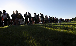 People queuing in Wimbledon Park on day two of the Wimbledon Championships at the All England Lawn Tennis and Croquet Club, Wimbledon.