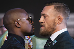 August 23, 2017 - Las Vegas, Nevada, U.S. - Boxers FLOYD MAYWEATHER and CONOR MCGREGOR face-off during a press conference before their fight in Las Vegas. (Credit Image: © Joel Marklund/Bildbyran via ZUMA Wire)