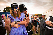 Glastonbury Festival, 2015.<br /> A fun intereaction between the police and a young festival goer in a dress and face paint.