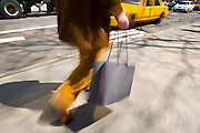 A shopper walks along the streets of New York.