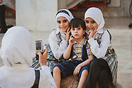 Syrian children pose for a photograph at the Umayyad Mosque in Damascus, Syria. (June 2010)