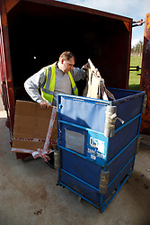 Man with a mild learning disability working as a factory cleaner, shown here recycling cardboard boxes, helped into employment by the Ready 4 Work team, Nottinghamshire County Council