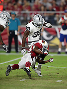 Arizona Cardinals rookie defensive back Matthias Farley (33) cross body blocks Oakland Raiders strong safety T.J. Carrie (38) during the 2016 NFL preseason football game against the Oakland Raiders on Friday, Aug. 12, 2016 in Glendale, Ariz. The Raiders won the game 31-10. (©Paul Anthony Spinelli)