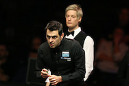 Ronnie O'Sullivan looks on during the final match against Neil Robertson (back). .Betvictor Welsh Open snooker 2016, Final day at the Motorpoint Arena in Cardiff, South Wales on Sunday 21st  Feb 2016.  <br /> pic by Andrew Orchard, Andrew Orchard sports photography.