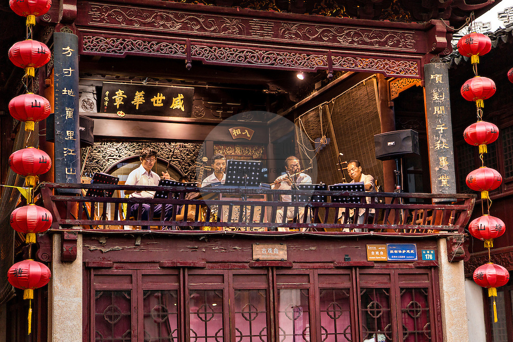 Traditional Chinese musicians play from the Ancient Opera Stage at Shantang canal in Suzhou, China.