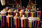Brightly coloured sacks of spices and nuts on sale in the Souk in Cairo, Egypt