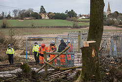 Steeple Claydon, UK. 24 February, 2021. Trees felled by HS2 Ltd using a long reach tree felling vehicle in ancient woodland known as Poors Piece are pictured during the eviction of activists opposed to the HS2 high-speed rail link. The activists created the Poors Piece Conservation Project there in spring 2020 after having been invited to stay on the land by its owner, farmer Clive Higgins. Already, local village communities have been hugely impacted by HS2, with 550 acres of land seized including a large section of a nature reserve.