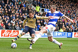 Leeds United's Ross McCormack and QPR's Richard Dunne  - Photo mandatory by-line: Mitchell Gunn/JMP - Tel: Mobile: 07966 386802 01/03/2014 - SPORT - FOOTBALL - Loftus Road - London - Queens Park Rangers v Leeds United - Championship