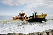 Caister lifeboat being launched by a tracked tractor in Caister, Norfolk