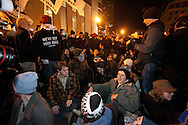 Boston, MA 12/09/2011.Occupy Boston protestors sit in the middle of Atlantic Avenue, stopping traffic after the passage of the deadline to vacate Dewey Square early Friday morning..Alex Jones / www.alexjonesphoto.com