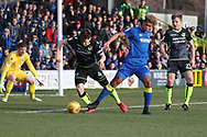 AFC Wimbledon striker Lyle Taylor (33) battles for possession with Bristol Rovers defender Tom Lockyer (4)  during the EFL Sky Bet League 1 match between AFC Wimbledon and Bristol Rovers at the Cherry Red Records Stadium, Kingston, England on 17 February 2018. Picture by Matthew Redman.