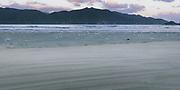 Dusk over beach in Doughboy Bay, The Southern Circuit, Stewart Island / Rakiura, New Zealand Ⓒ Davis Ulands | davisulands.com