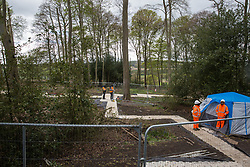 Wendover, UK. 4th May, 2021. Security guards stand behind fencing in ancient woodland at Jones Hill Wood in the Chilterns AONB, a large section of which is currently being cleared for the HS2 high-speed rail link. Felling of the woodland, which contains resting places and/or breeding sites for pipistrelle, barbastelle, noctule, brown long-eared and natterer's bats and is said to have inspired Roald Dahl's Fantastic Mr Fox, recommenced after a High Court judge refused an application for judicial review and lifted an injunction.