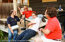 Michael Lichter interviewing Arlen Ness at his fabricator's, Bob Munroe's house, CA. Photography ©2005 Michael Lichter.