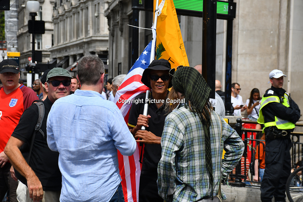 "How saves is London? Stop Tommy, Stop the Racists with all the police presents in the middle two group dislike each other interrupt to entire society and tourism? One side march to ""Free Tommy"" and another side anti-fascist both side seen quite aggressionson 3 August 2019, Oxford Street, London, UK"