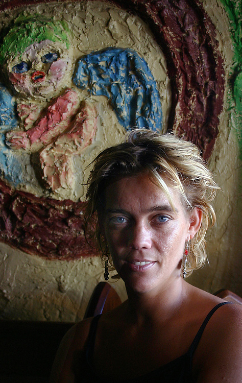 Ruth Allen, in front of Mirka Mora's artwork in her former business, Tolarnos, St Kilda. She now co-owns Barney Allen's.