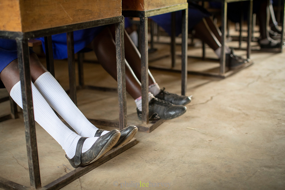 Low section view of African pupils sitting in Musoto Christian School, Uganda