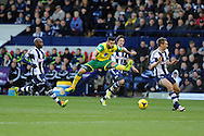 Norwich city's Bradley Johnson © fires a shot just wide of the goal. Barclays Premier league, West Bromwich Albion v Norwich city at the Hawthorns in West Bromwich, England on Sat 7th Dec 2013. pic by Andrew Orchard, Andrew Orchard sports photography.