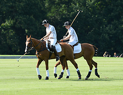 HRH THE DUKE OF CAMBRIDGE (white no 4 shirt) and HRH PRINCE HARRY OF WALES (white no 1 shirt)  at the Audi Polo Challenge 2013 at Coworth Park Polo Club, Berkshire on 3rd August 2013.
