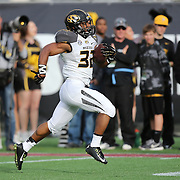 ORLANDO, FL - JANUARY 01: Russell Hansbrough #32 of the Missouri Tigers runs the ball for a touchdown during the Buffalo Wild Wings Citrus Bowl between the Minnesota Golden Gophers and the Missouri Tigers at the Florida Citrus Bowl on January 1, 2015 in Orlando, Florida. (Photo by Alex Menendez/Getty Images) *** Local Caption *** Russell Hansbrough