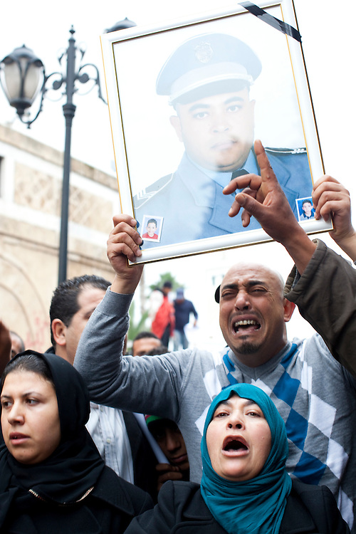 Tunis, Tunisia. January 25th 2011.In front of the Prime Minister's office (Mohammed Ghannouchi), on the Kasbah Square, a man and a woman show people the picture of their killed brother during the deadly riots twelve days ago.......