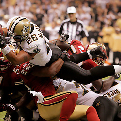 2008 September 28: New Orleans Saints running back Deuce McAllister (26) leaps into the end zone for a touchdown over San Francisco 49ers running back Michael Robinson (24) during the second half of the NFL week four game between the San Francisco 49ers and the New Orleans Saints at the Louisiana Superdome in New Orleans, LA.