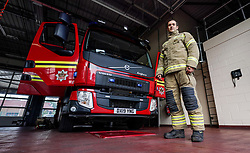 Former football player now fire fighter, Alex Nicholls poses for a picture at the Haden Cross fire station in Halesowen, Birmingham. After nine clubs, 66 goals and 429 appearances former forward Nicholls walked away from the game completely to become a firefighter. Having spent his entire adult life in the football bubble, coming through the youth system at Walsall, the 33-year-old is relishing the real world. Issue date: Thursday October 7, 2021.