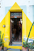 A brightly painted colonial style building in the Barrio Antiguo or Spanish Quarter neighborhood adjacent to the Macroplaza Grand Plaza in Monterrey, Nuevo Leon, Mexico.