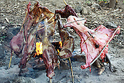 Africa, Tanzania, Maasai tribe an ethnic group of semi-nomadic people meat is cooked over a open fire