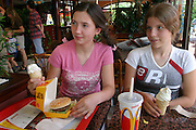 """(MODEL RELEASED IMAGE). Marzena Sobczynska worries that her 13-year-old daughter Klaudia (pictured with friend Ola) doesn't appreciate the foods that are available to her. """"She lives at a different time than I did,"""" says Marzena, who grew up when food was difficult to get during Poland's communist rule. (Supporting image from the project Hungry Planet: What the World Eats.) The Sobczynscy family of Konstancin-Jeziorna, Poland, is one of the thirty families featured, with a weeks' worth of food, in the book Hungry Planet: What the World Eats."""