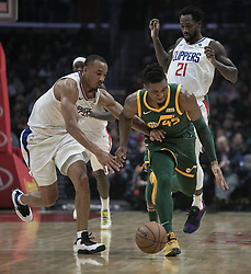 January 16, 2019 - Los Angeles, California, United States of America - Patrick Beverley #21 of the Los Angeles Clippers goes for the ball against Donovan Mitchell #45 of the Utah Jazz during their NBA game  on Wednesday January 16, 2019 at the Staples Center in Los Angeles, California. Clippers lose to Jazz, 129-109. JAVIER ROJAS/PI (Credit Image: © Prensa Internacional via ZUMA Wire)