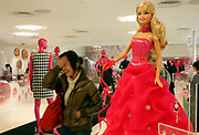Visitors look and play with the merchandise during the Media Sneak Preview of the new Barbie Shanghai flagship store in Shanghai, China on 20 February 2009.  The Barbie store has become a hit in Shanghai as a place where doting mothers take their daughters, often the only child in the family, for a girls' day out.