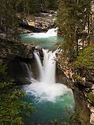 View of a small waterfall along Johnston Creek, Johnston Canyon; Banff National Park, Alberta, Canada.