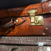Suitcases on display at an antique stall in Portobello Road market