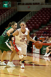 13 November 2005: Megan McCracken drives past Kalena Kenney.  With a final score was 93-58, the Illinois State University Redbirds overcome the Bearcats of Northwest Missouri State in an exhibition match up Sunday afternoon at Redbird Arena in Normal Illinois.  The final score was 93-58.