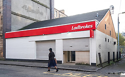 Austere Ladbrokes betting shop in Govanhill district of Glasgow, Scotland, United Kingdom