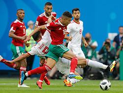 June 15, 2018 - Saint Petersburg, Russia - Amine Harit (C) of Morocco national team vies for the ball with Omid Ebrahimi of IR Iran national team during the 2018 FIFA World Cup Russia Group B match between Morocco and IR Iran on June 15, 2018 at Saint Petersburg Stadium in Saint Petersburg, Russia. (Credit Image: © Mike Kireev/NurPhoto via ZUMA Press)