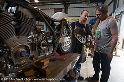 Bill Dodge shows Bean're what he is doing with Jim Root's (from the band Slipknot) custom Harley-Davidson FXR in his Blings Cycle shop during Daytona Bike Week 75th Anniversary event. FL, USA. Friday March 4, 2016.  Photography ©2016 Michael Lichter.